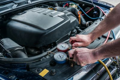 stock-photo-22306623-recharging-car-with-freon